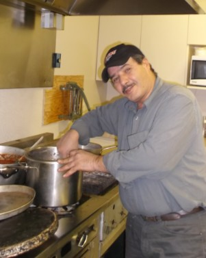 photo of cook in his kitchen