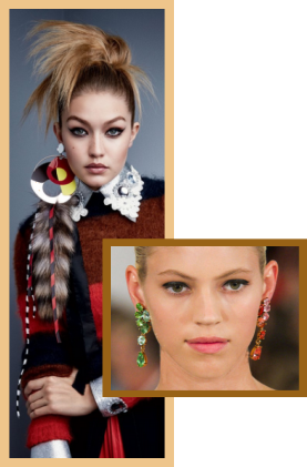 Large asymmetrical earrings on fashion models
