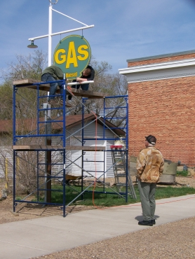 Installing Empress gas sign