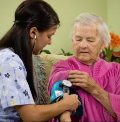 Homecare nurse taking patient's blood pressure