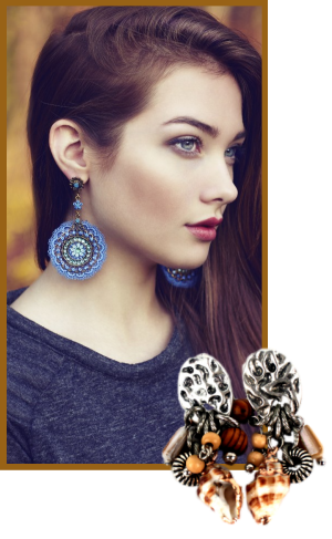 A model wearing very large circular drop earrings.  A second pair of brown beaded drop earrings is also shown.