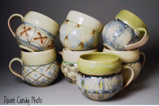 A photo of handmade pottery mugs by Dawn Candy